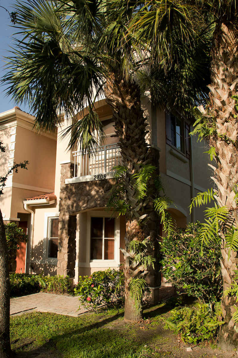 Two Story End Unit Town Home Surrounded by Palm Trees